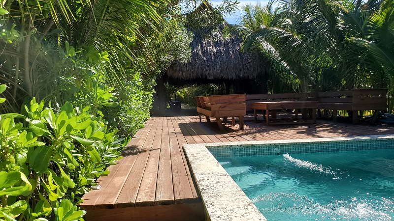 Coral-Views-Becash-side-community-pool-with-palapa-and-deck